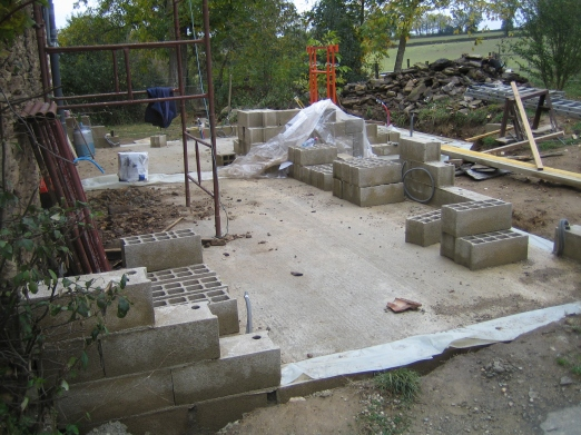 Concrete base laid and the block wall starting to rise.