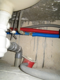 New pipes under a sink.