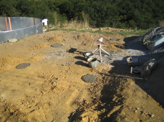 Once the ground is roughly level holes are dug for concrete footings.