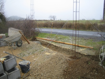 A trench is dug and reinforcement steelwork installed to support the gate posts.