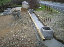 The gatepost positions are carefully measured and the first blocks laid.
