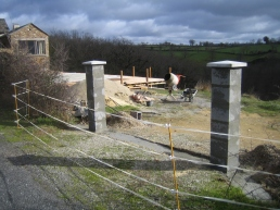 Cap stones fitted. We now have two reinforced concrete pillars.