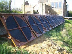 All in a row. The support arms at the bottom of each panel allow two angles to be used to optimise solar collection during spring/autumn and summer.