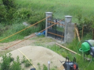 After a couple of weeks or so when the concrete has fully cured the gates are hung.
