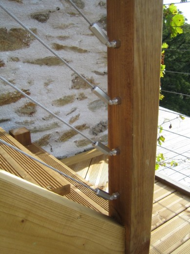 Detail of the baluster wires. These tie in with the rest of the deck. Their 'high tech' appearance contrast nicely with the timber.