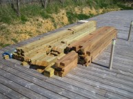 All pieces cut to size, joints made and sealed, delivered to site and ready to assemble.