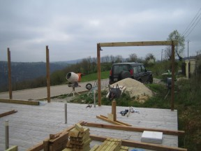 The back row of posts are fitted, this is the first of the main beams to support the roof.