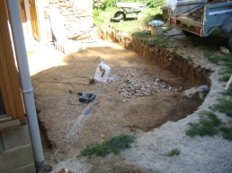 The ground has been dug out to a suitable level so building work can begin.