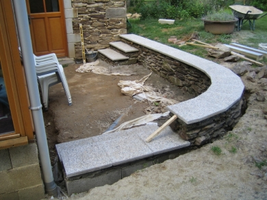 Here the wall and steps are completed with the flags mortared into place.