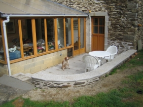The finished patio, with dog approval! It's become a favourite corner when the sun shines.