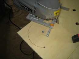 Experimenting with a jigsaw to cut large diameter holes.