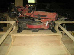 The saw is attached to a piece of ply so that it can quickly be fitted to the bench.