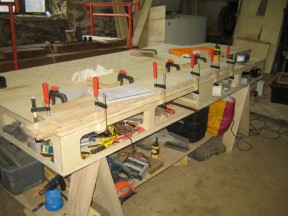 Glueing the extension arms. These are made of two sheets of ply laminated for strength.