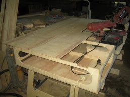 Fitting the bench top. the rear is fitted first then the pieces either side of the saw.